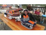 William Power with his magnificent 37ft Oakley lifeboat RNLB Har-Lil and its carriage and tractor.