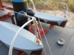 Stainless steel wire has been used for the rigging and the boat covers are from paper cut to size.
