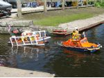 The Chandlers' DUKW pulls the trailer and Atlantic class RIB lifeboat into the water.