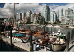 General view of part of the Wooden Boat Show in False Creek with the Chris Craft Constellation left foreground.