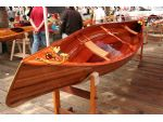 An exquisite wooden kayak in the shoreside exhibition.