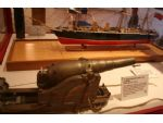 A small display model of HMS Warrior together with a very nicely modelled 7 inch muzzle loader of the type fitted to the ship.