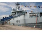 HMS Enterprise. The gangway leads up to the helipad immediately forward of the bridge.