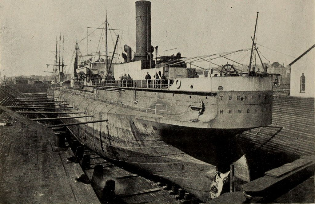 1920px-turret_age_(1893)_of_newcastle-upon-tyne_in_the_dry_dock_st._johns_newfoundland_in_1899_(1902)_(14793900823).jpg